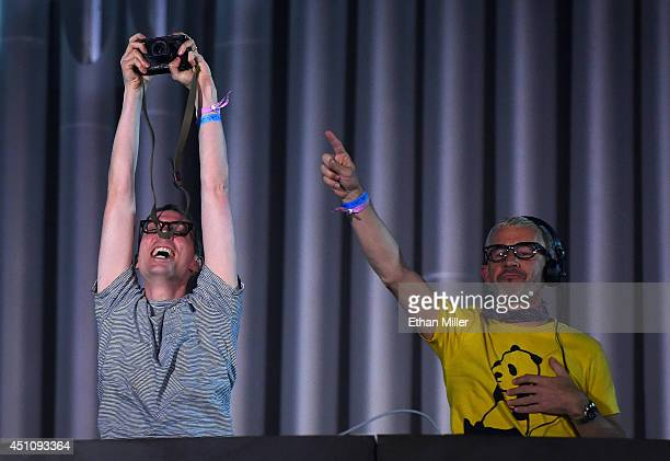 Recording artist Paavo Siljamaki takes a photo of the crowd as he and Tony McGuinness of Above Beyond perform during the 18th annual Electric Daisy...