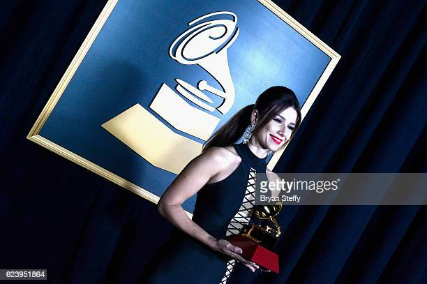 Recording artist Paula Fernandes poses with the Best Sertaneja Music Album during The 17th Annual Latin Grammy Awards Premiere Ceremony at MGM Grand...