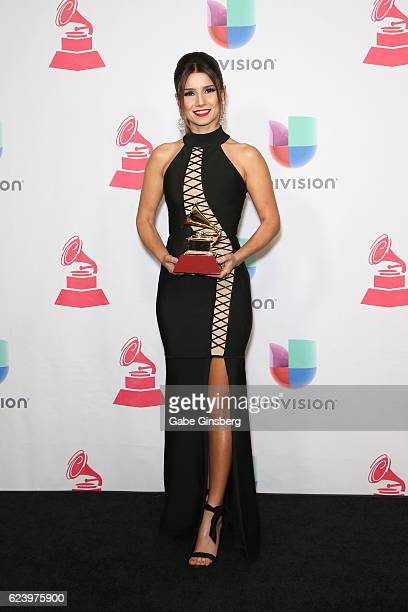 Recording artist Paula Fernandes poses with the Best Sertaneja Music Album award in the press room during The 17th Annual Latin Grammy Awards at...