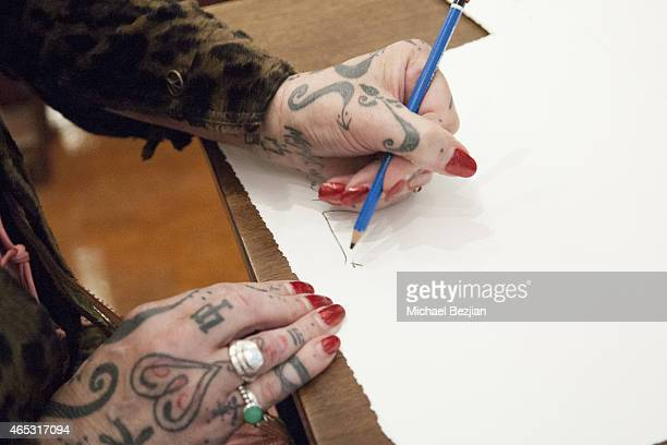 Recording Artist Pearl Thompson of The Cure tattoo and jewelry detail presents a solo art exhibition at Mr Musichead Gallery on March 5 2015 in Los...