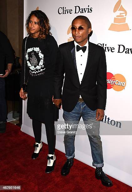 Recording artist Pharrell Williams and Helen Lasichan attend the PreGRAMMY Gala and Salute To Industry Icons honoring Martin Bandier on February 7...