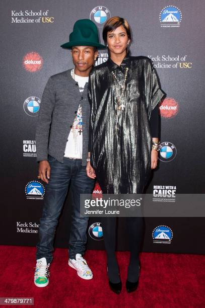 Recording artist Pharrell Williams and Helen Lasichanh attends the 2nd Annual Rebel With A Cause Gala hosted at the Paramount Studios on March 20...