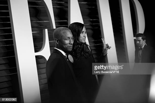 Recording artist Pharrell Williams and model/fashion designer Helen Lasichanh attend the 2016 Vanity Fair Oscar Party hosted by Graydon Carter at...