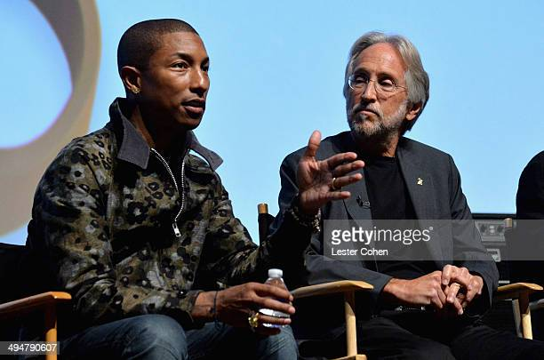 Recording artist Pharrell Williams and National Academy of Recording Arts and Sciences President Neil Portnow speak onstage during A Conversation...