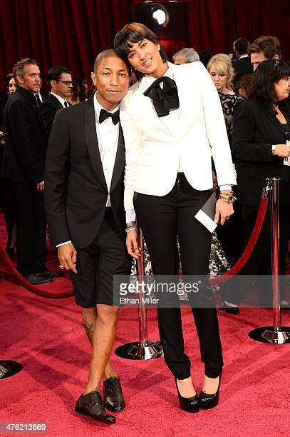 Recording artist Pharrell Williams and wife Helen Lasichanh attend the Oscars held at Hollywood Highland Center on March 2 2014 in Hollywood...