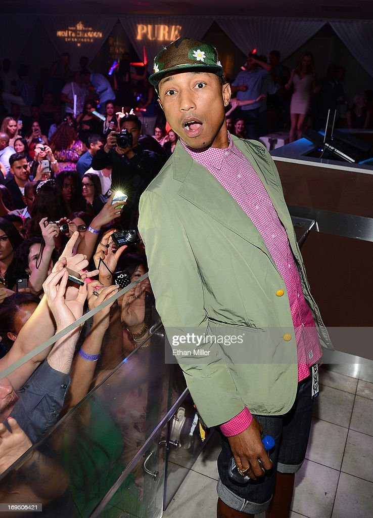 Recording artist Pharrell Williams appears before performing at the Pure Nightclub at Caesars Palace to celebrate Memorial Day weekend on May 26, 2013 in Las Vegas, Nevada.