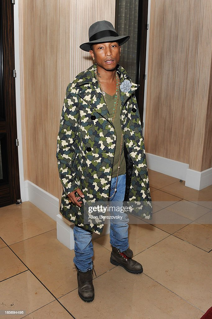 Recording artist Pharrell Williams attends the Fulfillment Fund Stars 2013 Benefit Gala at The Beverly Hilton Hotel on October 23, 2013 in Beverly Hills, California.