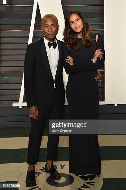 Recording artist Pharrell Williams L0 and Helen Lasichanh arrive at the 2016 Vanity Fair Oscar Party Hosted By Graydon Carter at Wallis Annenberg...
