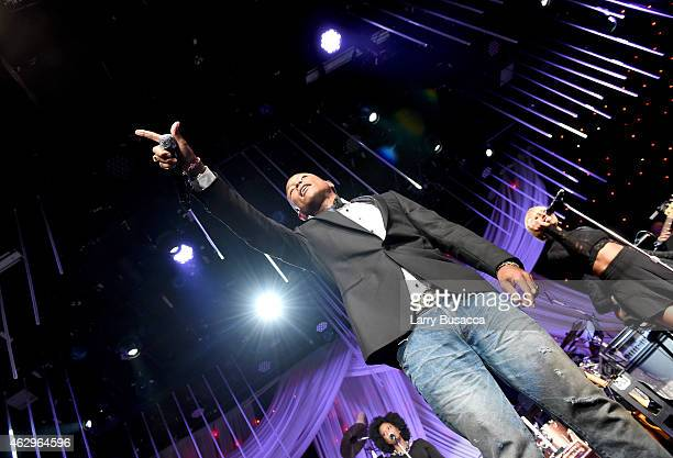 Recording artist Pharrell Williams performs onstage at the PreGRAMMY Gala and Salute To Industry Icons honoring Martin Bandier at The Beverly Hilton...