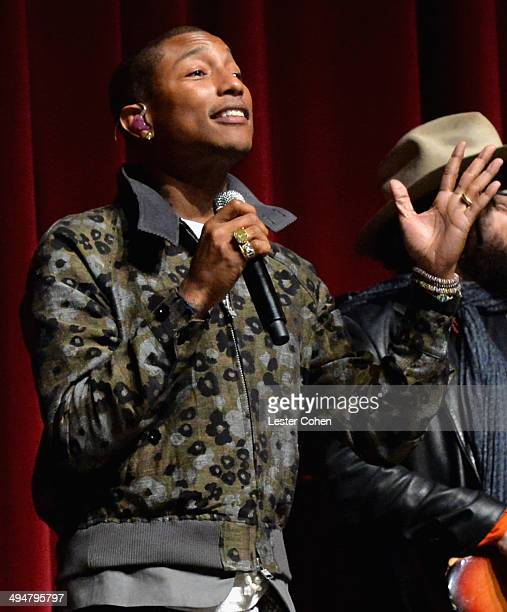 Recording artist Pharrell Williams performs onstage during A Conversation About the 56th GRAMMYS And Beatles Show at Leonard H Goldenson Theatre on...
