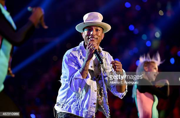 Recording artist Pharrell Williams performs onstage during Nickelodeon Kids' Choice Sports Awards 2014 at UCLA's Pauley Pavilion on July 17 2014 in...