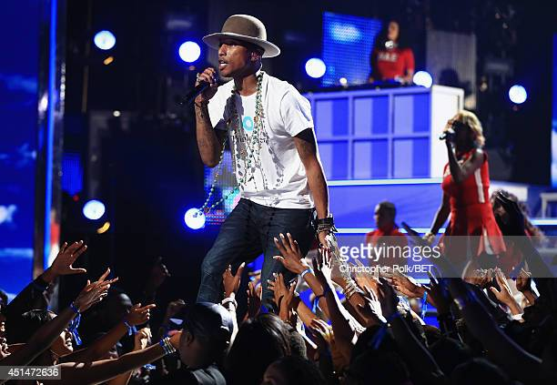 Recording artist Pharrell Williams performs onstage during the BET AWARDS '14 at Nokia Theatre LA LIVE on June 29 2014 in Los Angeles California
