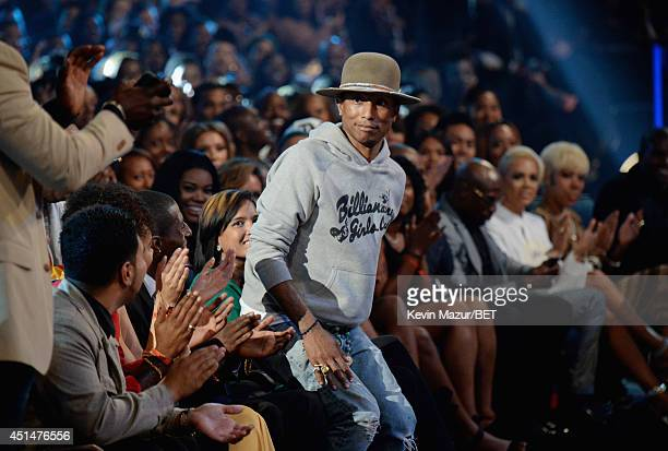 Recording artist Pharrell Williams walks onstage during the BET AWARDS '14 at Nokia Theatre LA LIVE on June 29 2014 in Los Angeles California