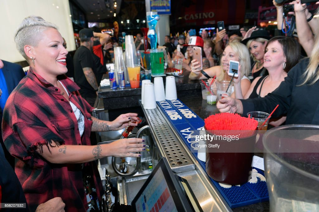 Recording artist Pink (L) attends a surprise event in support of her husbands foundation Carey Hart's Good Ride Rally benefiting the Infinite Hero Foundation at The D Bar, at the D Las Vegas on October 5, 2017 in Las Vegas, Nevada.
