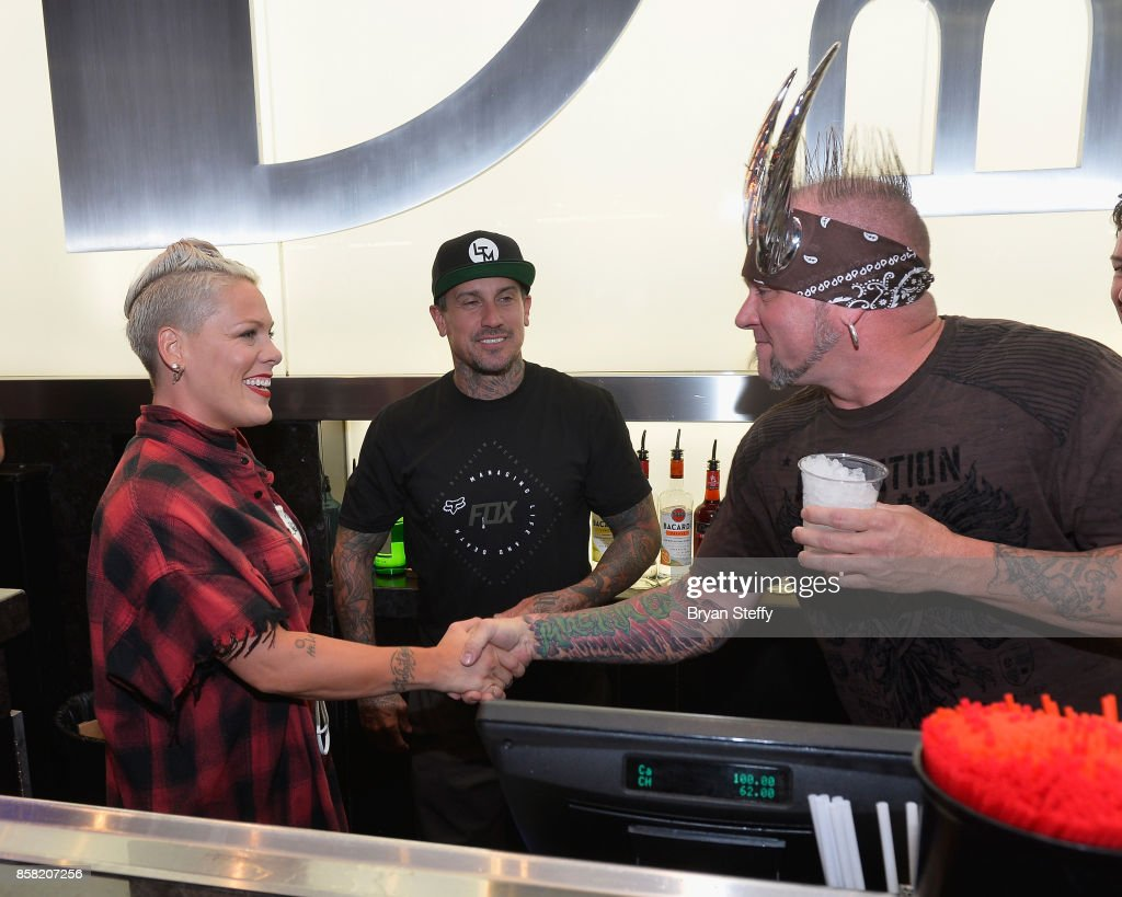 Recording artist Pink, freestyle motocross rider Carey Hart and television personality 'Horny' mike Henry attend a surprise event in support of Carey Hart's Good Ride Rally benefiting the Infinite Hero Foundation at The D Bar, at the D Las Vegas on October 5, 2017 in Las Vegas, Nevada.
