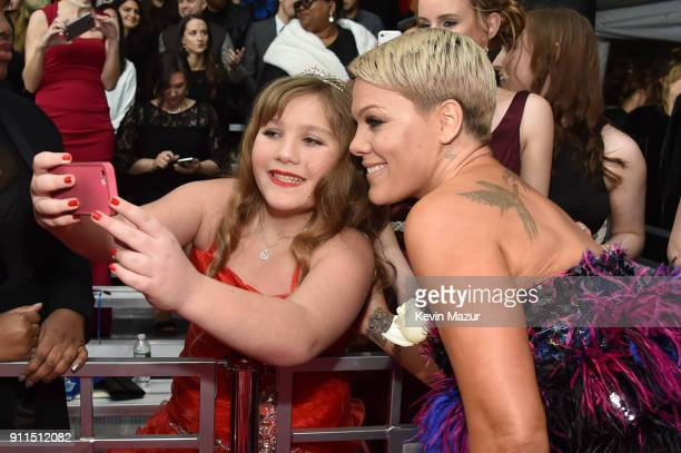 Recording artist Pink takes a selfie with a fan at the 60th Annual GRAMMY Awards at Madison Square Garden on January 28 2018 in New York City