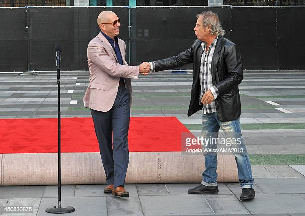 Recording artist Pitbull and music producer Larry Klein attend the 2013 American Music Awards press conference held at Nokia Plaza L.A. LIVE on...
