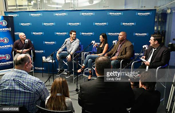 Recording artist Pitbull and SiriusXM hosts Rich Davis Stanley T Nicole Ryan and Ryan Sampson take part in a SiriusXM 'Town Hall' special on SiriusXM...