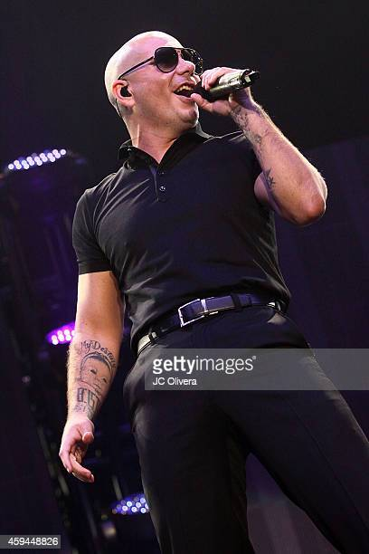 Recording artist Pitbull performs on stage during iHeartRadio Fiesta Latina Music Festival at The Forum on November 22 2014 in Inglewood California