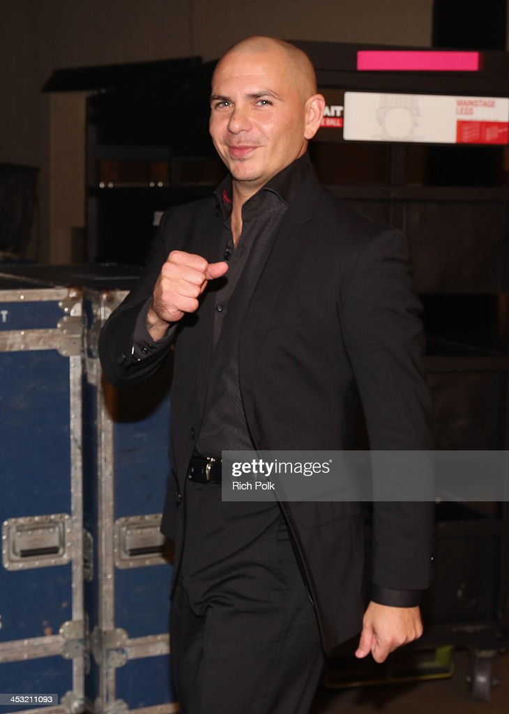 Recording artist Pitbull poses backstage at 106.1 KISS FM's Jingle Ball 2013 American Airlines Center at on December 2, 2013 in Dallas, Texas.