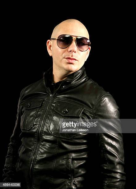Recording artist Pitbull poses backstage during the iHeartRadio Fiesta Latina festival presented by Sprint at The Forum on November 22 2014 in...