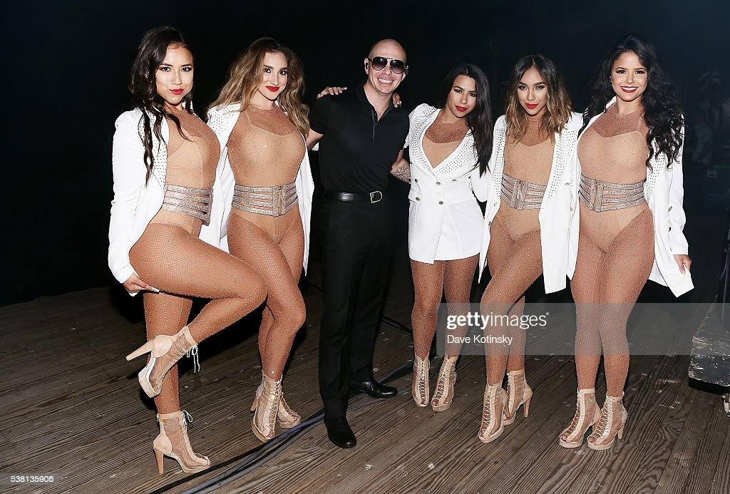 Recording artist Pitbull poses with dancers backstage during 103.5 KTU's KTUphoria 2016 presented by Aruba, at Nikon at Jones Beach Theater on June 4, 2016 in Wantagh, NY.