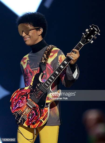 Recording artist Prince performs with singer Mary J Blige onstage during the 2012 iHeartRadio Music Festival at the MGM Grand Garden Arena on...