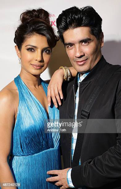 Recording artist Priyanka Chopra and designer Manish Malhotra attend the 'I Can't Make You Love Me' video premiere at Tribeca Grand Hotel on April 28...