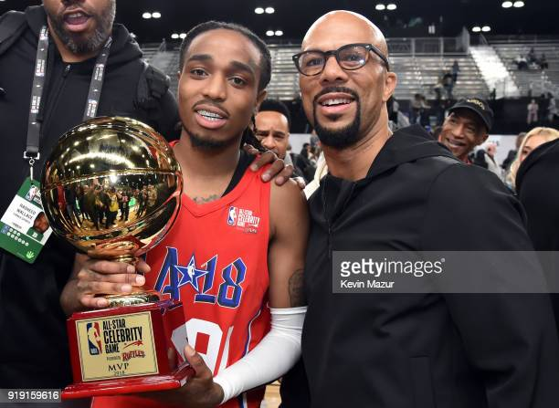 Recording artist Quavo poses with his Celebrity AllStar MVP trophy with coach Common during the NBA AllStar Celebrity Game 2018 presented by Ruffles...