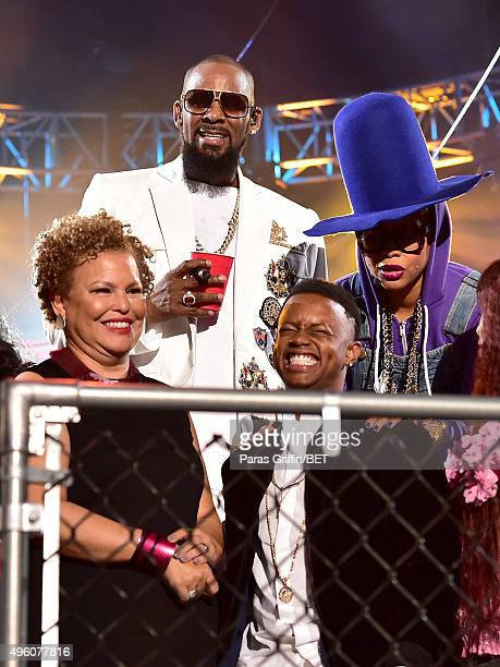 Recording artist R. Kelly, host Erykah Badu and Chairwoman and CEO of BET Networks Debra Lee and recording artist Silento onstage during the 2015...