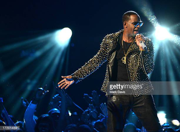 Recording artist R Kelly performs onstage during the 2013 BET Awards at Nokia Theatre LA Live on June 30 2013 in Los Angeles California