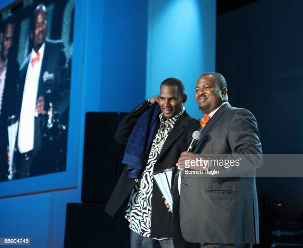 Recording artist R. Kelly receives a award from Nduka Nduka Obaigbena, CEO of THISDAY Group during the ARISE Africa Fashion Awards at Sandton...