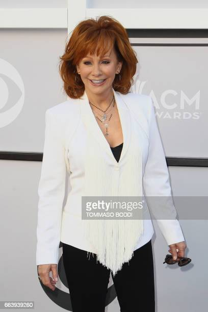 Recording artist Reba McEntire arrives for the 52nd Academy of Country Music Awards on April 2 at the TMobile Arena in Las Vegas Nevada / AFP PHOTO /...