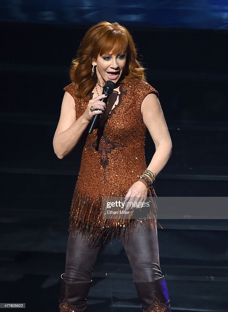 Recording artist Reba McEntire performs during the opening weekend of her residency 'Reba, Brooks & Dunn: Together in Vegas' with Kix Brooks and Ronnie Dunn (not pictured) at The Colosseum at Caesars Palace on June 19, 2015 in Las Vegas, Nevada.
