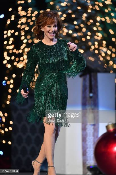 Recording Artist Reba McEntire performs on stage during 2017 CMA Country Christmas at The Grand Ole Opry on November 14 2017 in Nashville Tennessee