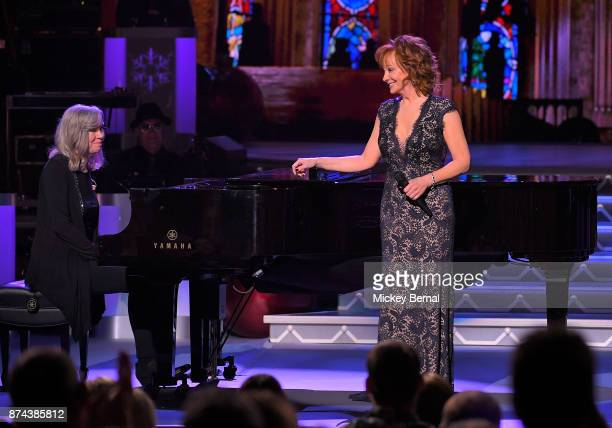 Recording artist Reba McEntire performs with Catherine Marx performs during CMA 2017 Country Christmas at The Grand Ole Opry on November 14 2017 in...
