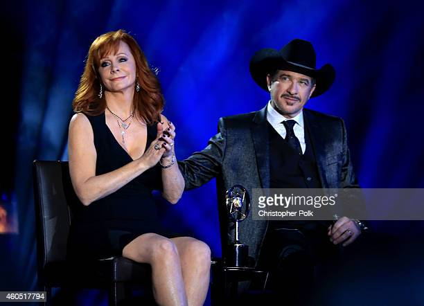 Recording artist Reba recipient of the NASH Icon Award speaks onstage with recording artist Kix Brooks at the 2014 American Country Countdown Awards...