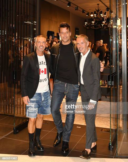 Recording artist Ricky Martin and fashion designers Dan Caten and Dean Caten attend the grand opening party for Dsquared2 at The Shops at Crystals on...
