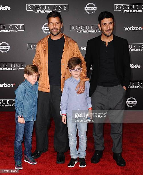Recording artist Ricky Martin artist Jwan Yosef and sons Matteo Martin and Valentino Martin attend the premiere of Rogue One A Star Wars Story at the...