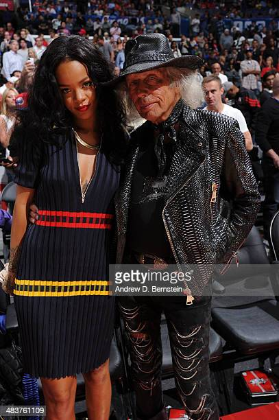 Recording artist Rihanna and NBA fan Jimmy Goldstein pose for a photograph at Staples Center on April 9 2014 in Los Angeles California NOTE TO USER...