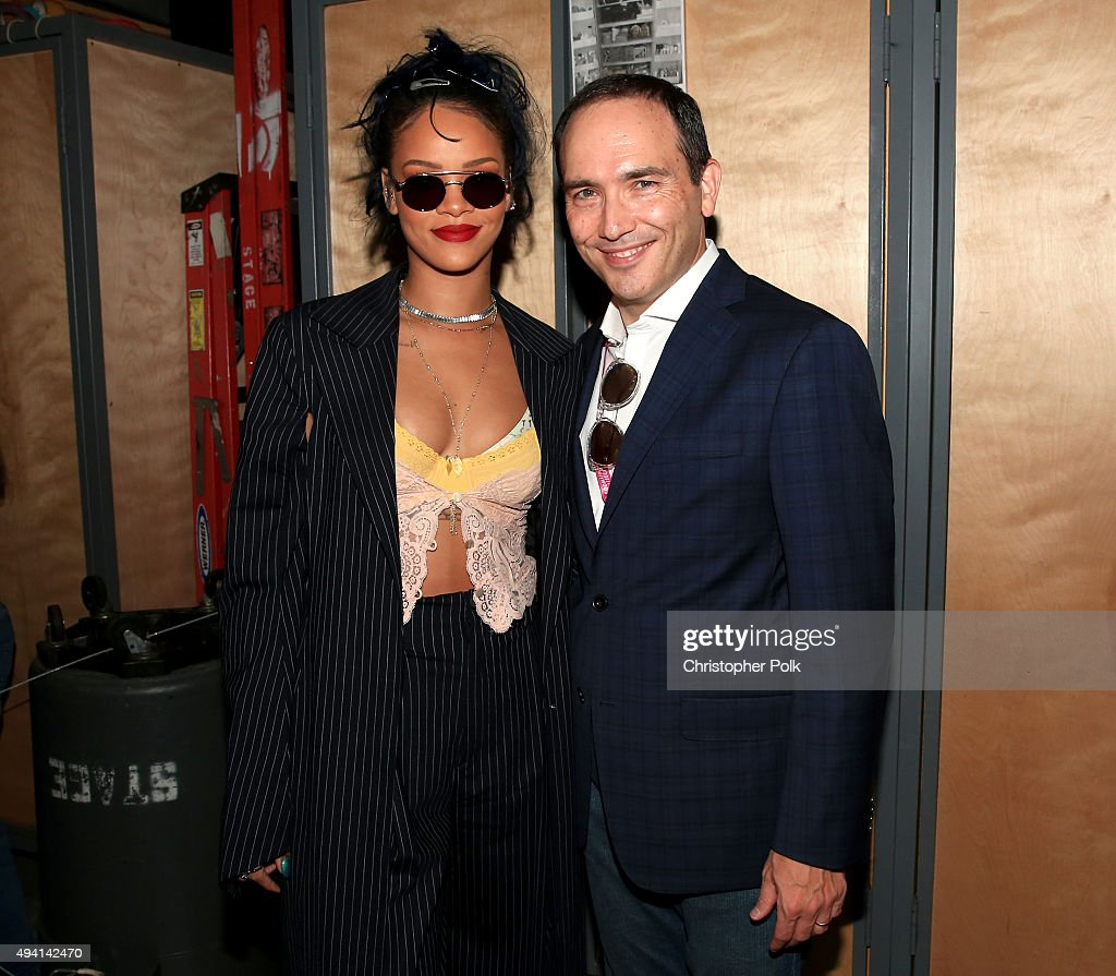 Recording artist Rihanna (L) and president of CBS RADIO Andre Fernandez during CBS RADIOs third annual We Can Survive, presented by Chrysler, at the Hollywood Bowl on October 24, 2015 in Hollywood, California.