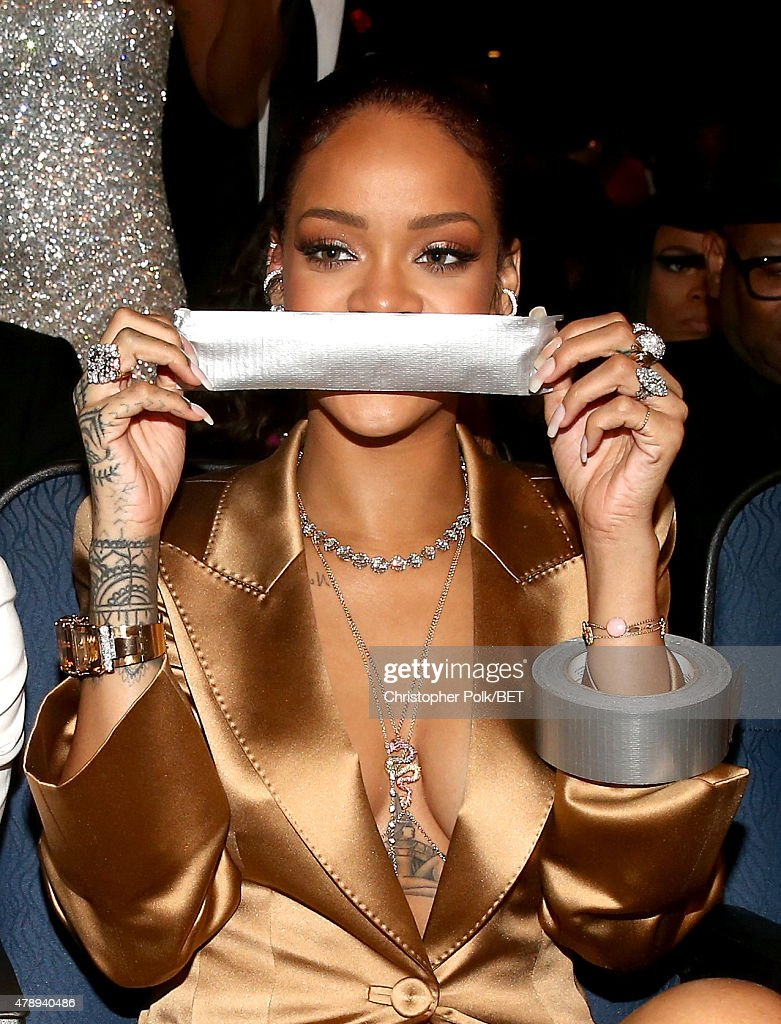 Recording artist Rihanna poses with a piece of duct tape at the 2015 BET Awards at the Microsoft Theater on June 28, 2015 in Los Angeles, California.