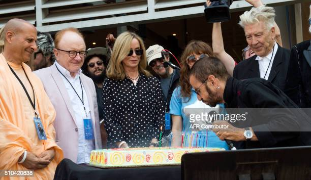 Recording artist Ringo Starr blows candles as wife Barbara Bach and director David Lynch friends and family look on during Ringo Starr's birthday...