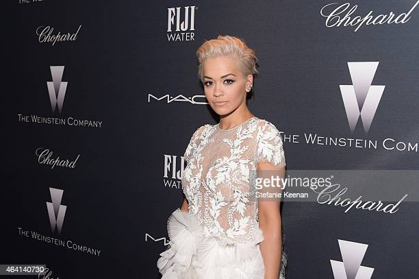 Recording artist Rita Ora attends The Weinstein Company's Academy Awards Nominees Dinner in partnership with Chopard DeLeon Tequila FIJI Water and...