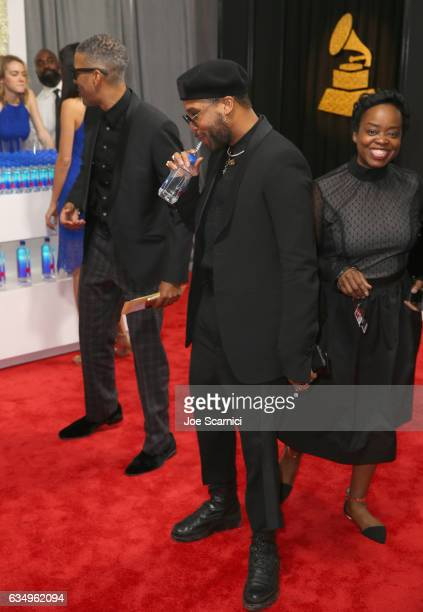 Recording artist Ro James drinks Fiji Water at The 59th Annual GRAMMY Awards at STAPLES Center on February 12 2017 in Los Angeles California