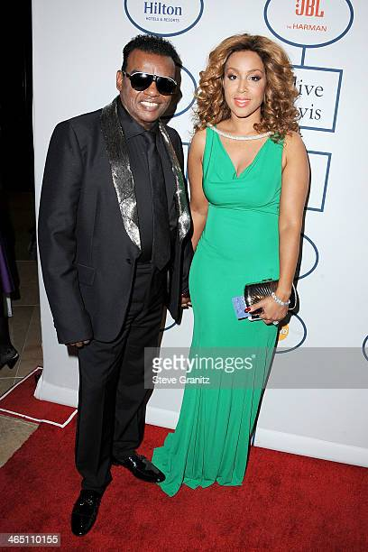 Recording artist Ron Isley and Kandy Isley attends the 56th annual GRAMMY Awards Pre-GRAMMY Gala and Salute to Industry Icons honoring Lucian Grainge...