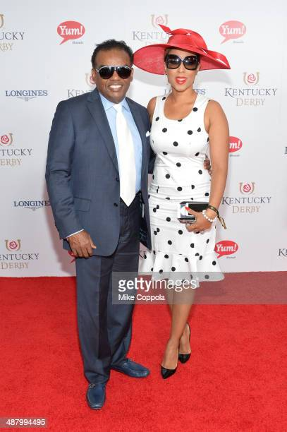 Recording artist Ronald Isley and Kandy Johnson Isley attend 140th Kentucky Derby at Churchill Downs on May 3 2014 in Louisville Kentucky