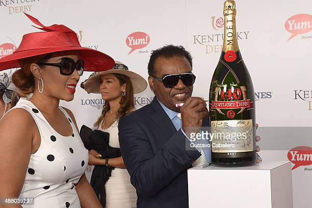 Recording artist Ronald Isley and Kandy Johnson Isley toast with Moet & Chandon at the 140th Kentucky Derby at Churchill Downs on May 3, 2014 in...