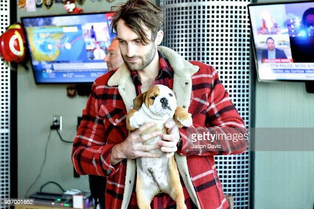 Recording Artist Ryan Hurd and dog Pancake visit SiriusXM Host Storme Warren on March 21 2018 in Nashville Tennessee