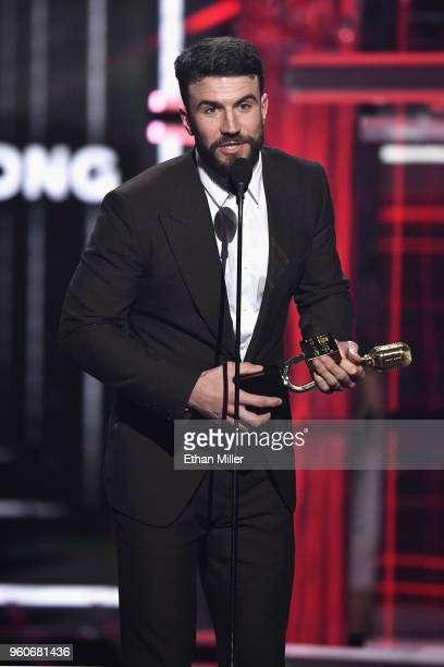 Recording artist Sam Hunt accepts an award onstage during the 2018 Billboard Music Awards at MGM Grand Garden Arena on May 20 2018 in Las Vegas Nevada